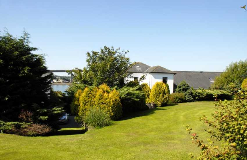 The spacious landscaped gardens are a delight with lawns, borders and shrubs