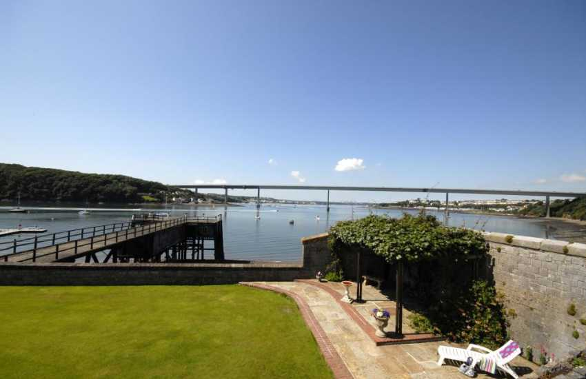 Views across the garden, patio and terrace to Pembroke Ferry and the Haven Waterway