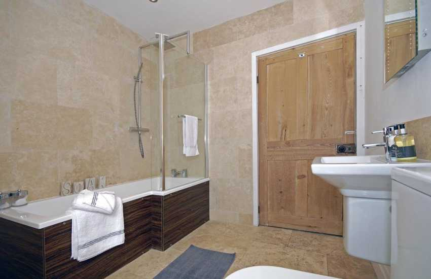 St Davids holiday cottage - luxury family bathroom with shower over bath