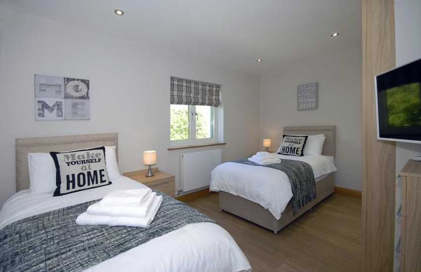 Luxury Pembrokeshire waterside apartment sleeps 4 - twin bedroom with t.v