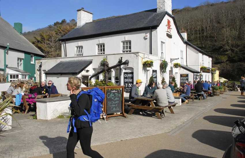 Solva - a picturesque harbour village with a handful of interesting shops, pottery, gallery and riverside pubs. Relax with friends exchanging gossip!