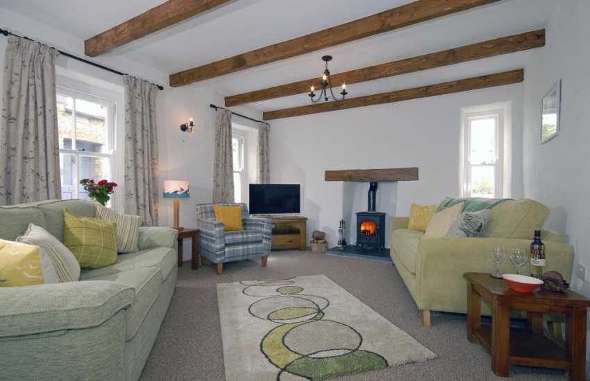St Davids restored holiday cottage - cosy lounge with wood burning stove - pets welcome