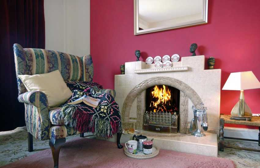 Cosy up by the open fire at Sundown, Newport Pembs