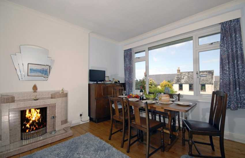 Self-catering cottage Newport - dining room with open fire