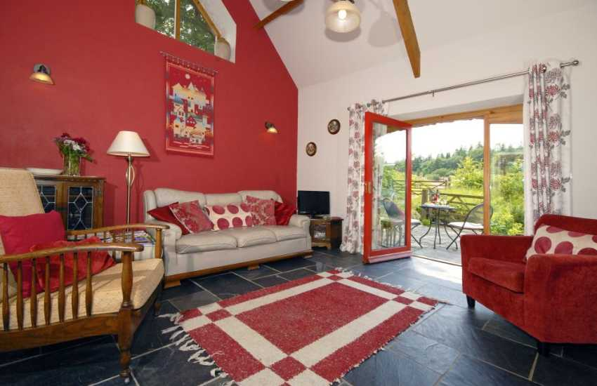 Canaston Woods holiday cottage - spacious lounge with doors to the patio