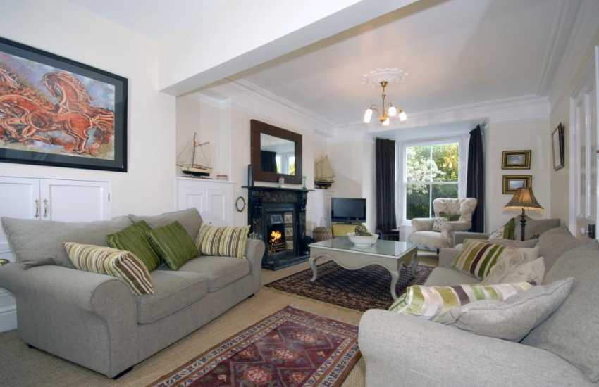 Tresaith self-catering holiday home - sitting room with open fire