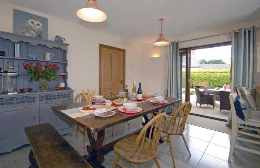 Self catering Bosherston Pembrokeshire - open plan dining room with french doors to the patio