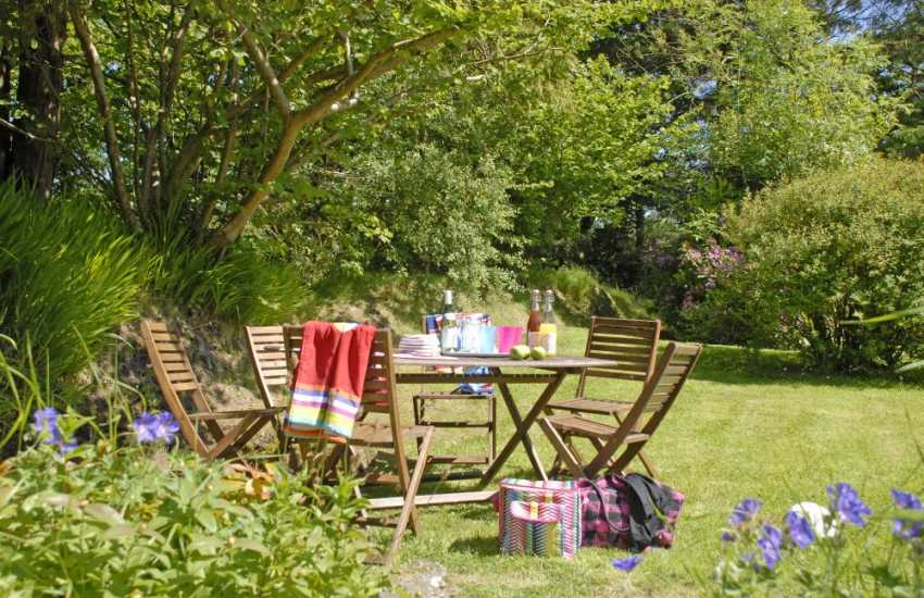 Relax in the private gardens at Stonehall Mill Cottage