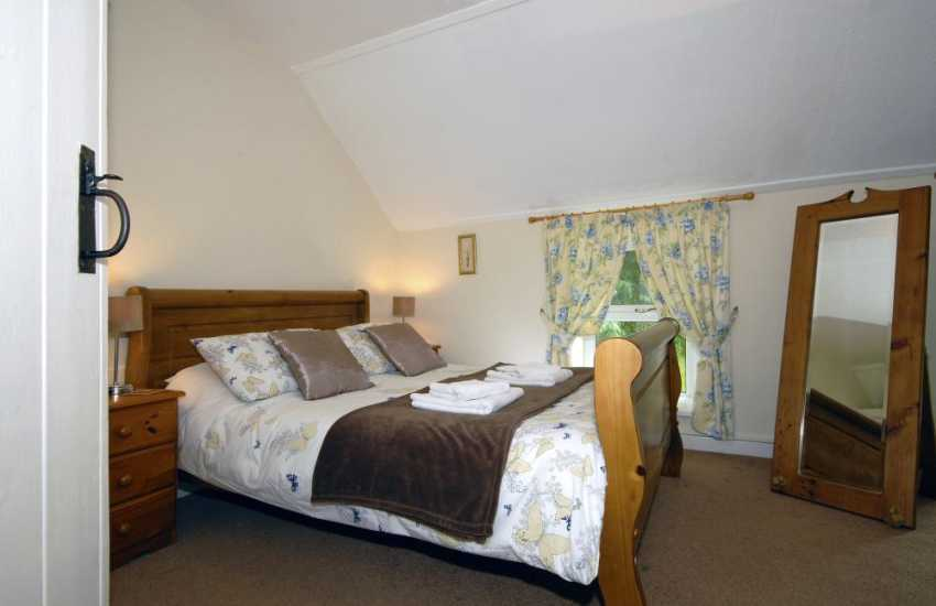 Newgale family holiday house - king size master bedroom with garden views
