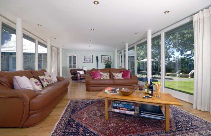 Luxury Pembrokeshire holiday home near the coast - lounge with floor to ceiling glass walls