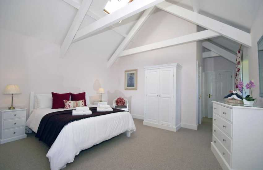 Coastal holiday cottage in Wales - master bedroom with en-suite