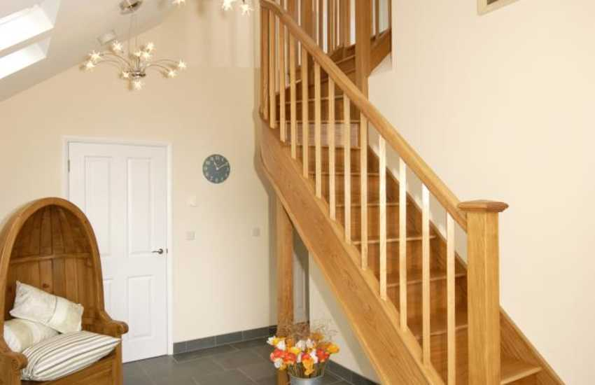 Stunning entrance hallway with a beautiful curved oak staircase