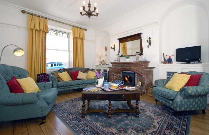New Quay holiday home - comfortable lounge with sea views and wood burning stove
