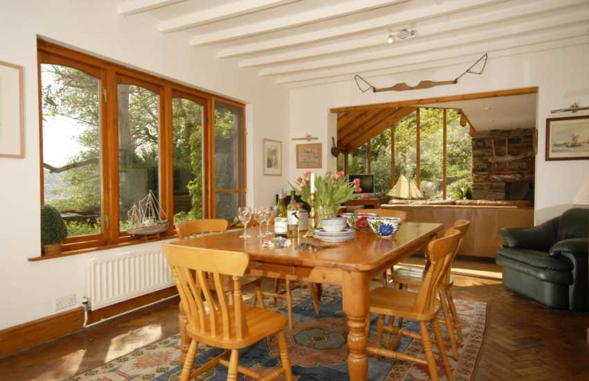 Coastal cottage for holidays - spacious dining hall with river views