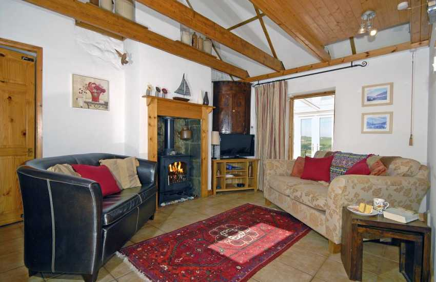 North Pembrokeshire cosy holiday home - sitting room with wood burning stove