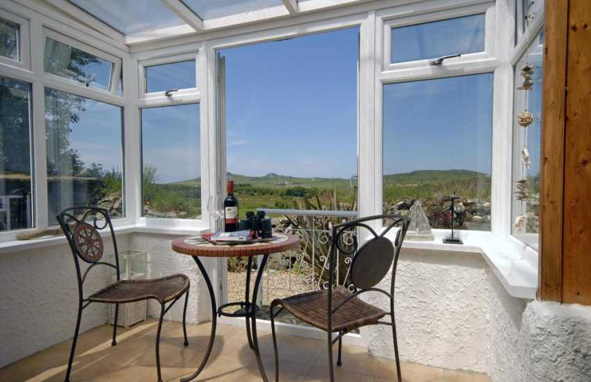 Strumble Head holiday cottage - sun room with moorland views