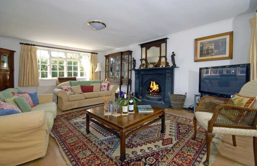 Southerndown holiday house near Dunraven Bay - sitting room with open fire