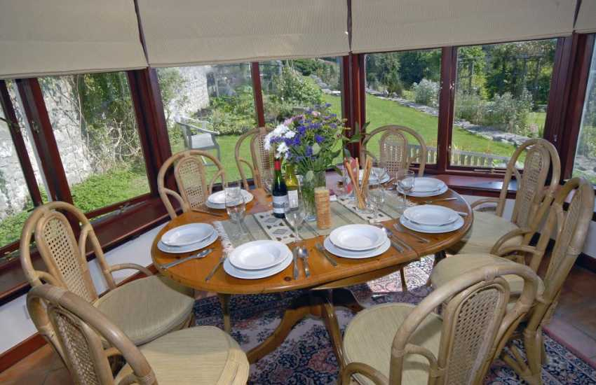 Relax with friends and family in the conservatory at Slade Cottage