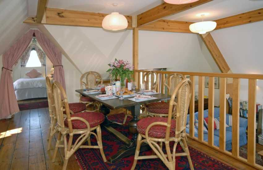 Dunraven Beach holiday cottage - galleried dining area