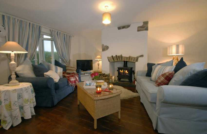Bosherston cosy holiday cottage - sitting room with log burning stove