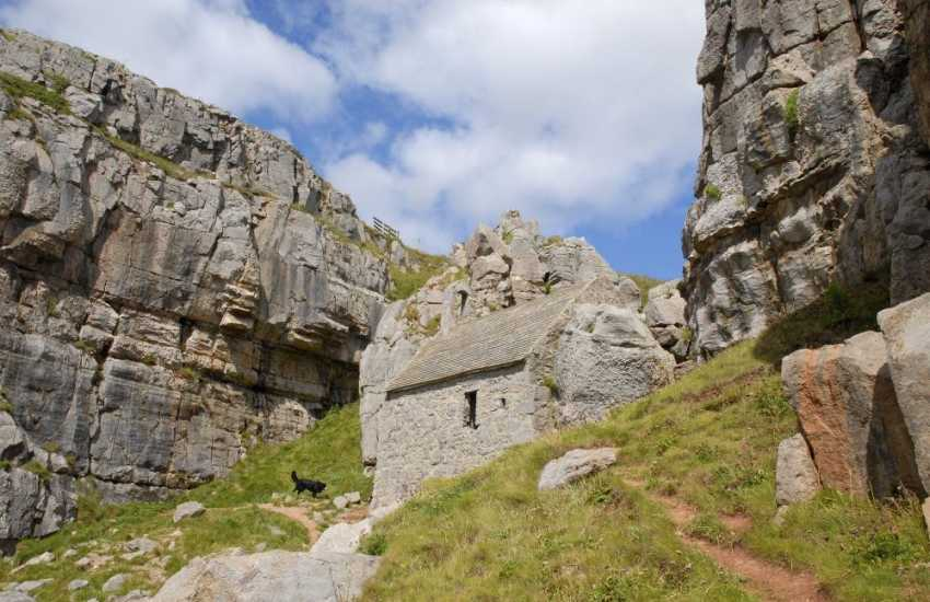 Secluded St Govan's Chapel - a tiny 6th century hermit's cell built into the limestone cliffs near Bosherston