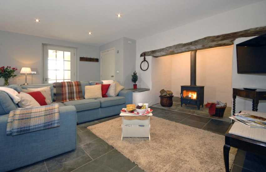 North Pembrokeshire restored holiday cottage near St Davids - cosy lounge with wood burning stove and inglenook fireplace