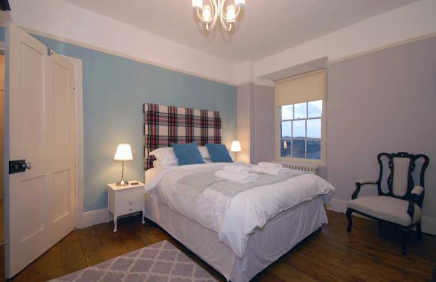 Pembrokeshire coastal holiday farmhouse - king size bedroom with countryside views