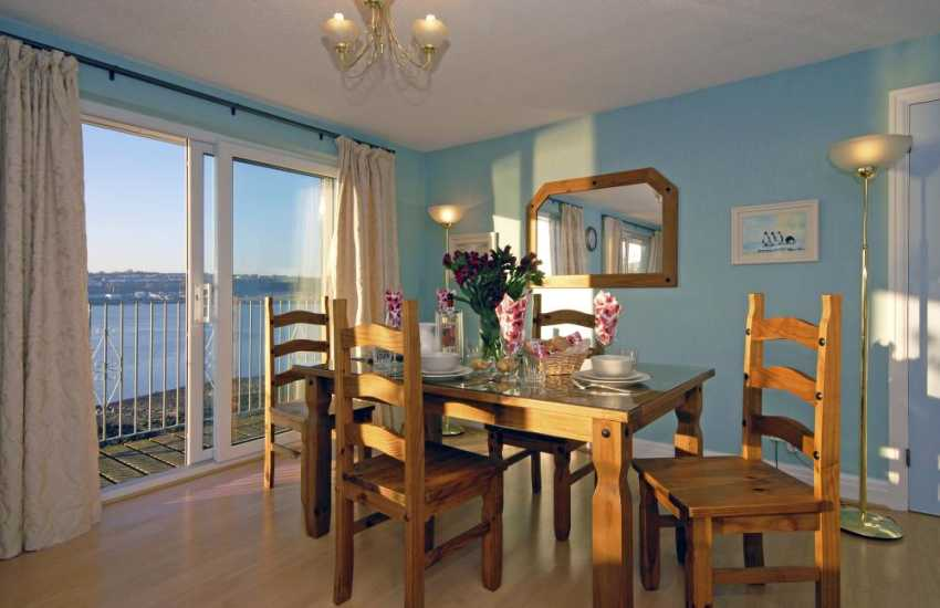 Pembrokeshire holiday house near the south coast - dining area with patio doors to the balcony and river views