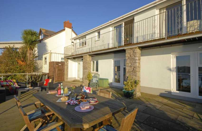 Pembrokeshire Haven Waterway holiday home with large deck and river views - pets welcome