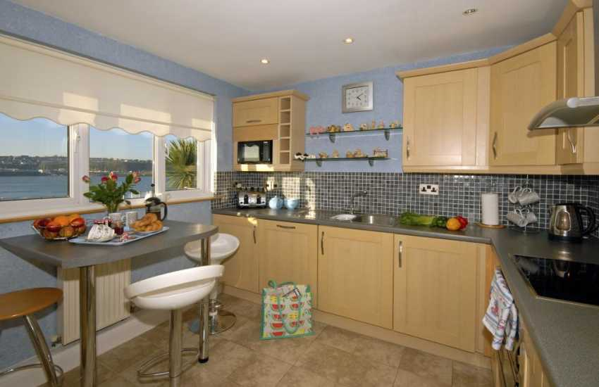 Self catering upside down house Pembrokeshire - modern kitchen with river views