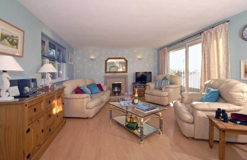 Pembrokeshire holiday home on the Milford Haven Waterway - sitting room with electric fire/WiFi/internet and river views