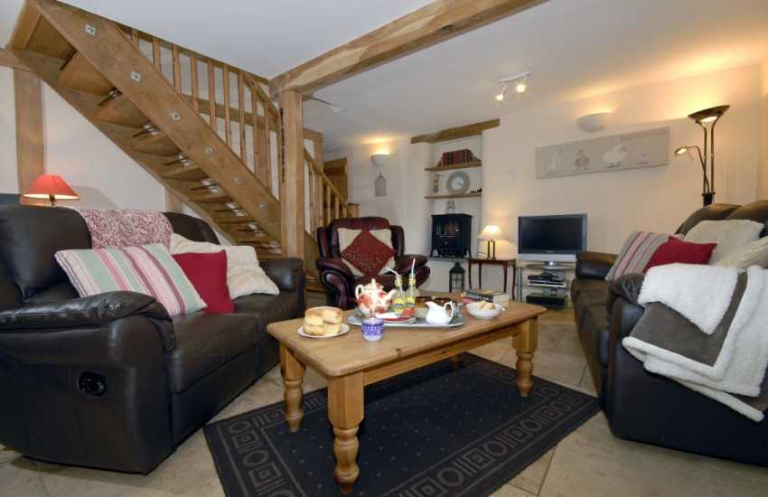 Cosy Pembrokeshire holiday cottage - sitting room with under floor heating and oak beams