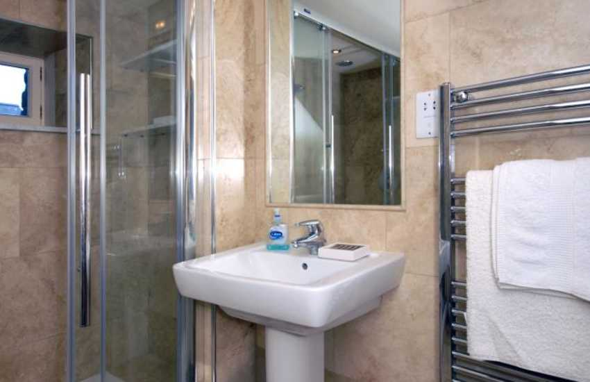 Newport holiday cottage - shower room with double walk-in shower and massage jets
