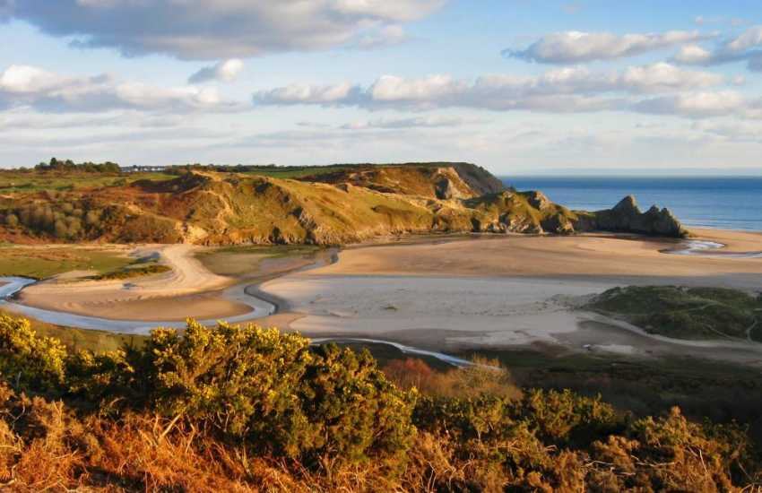 Beautiful Three Cliffs Bay (Blue Flag), on Gower's south coast is dog friendly all year round.