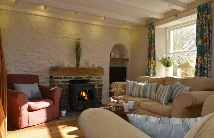 Solva holiday cottage sitting room with log burning stove