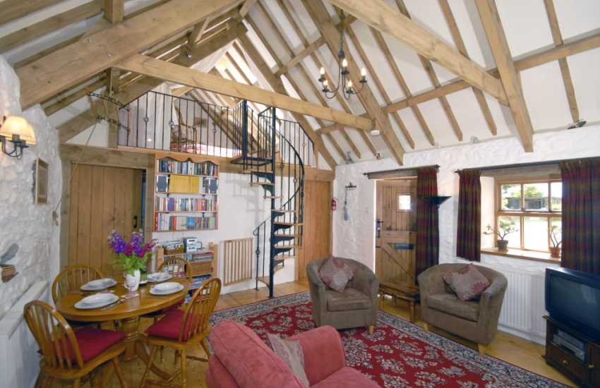 Strumble Head Pembrokeshire cosy cottage - lounge with wood burning stove and spiral staircase