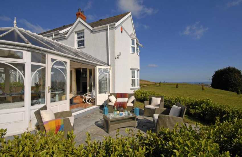 South Pembrokeshire restored family home with lawned gardens - patio area