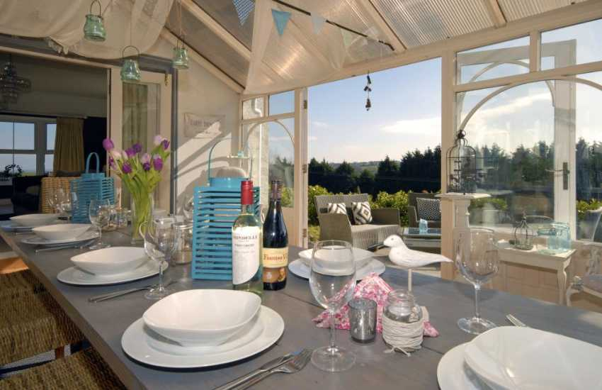 Saundersfoot luxury holiday home - conservatory with seating for 10 people