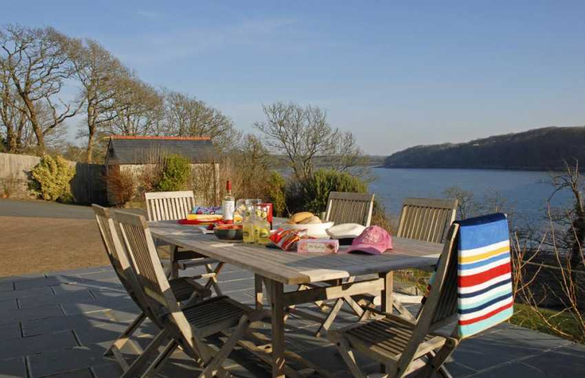 Enjoy breathtaking views up river across the shimmering expanse of Pembrokeshire Haven Waterway