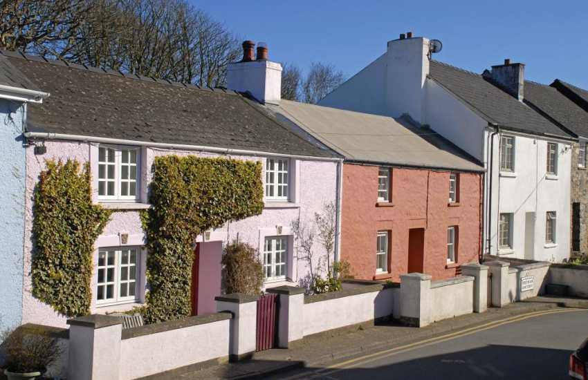 A row of pretty painted Welsh cottages are just opposite The Forge