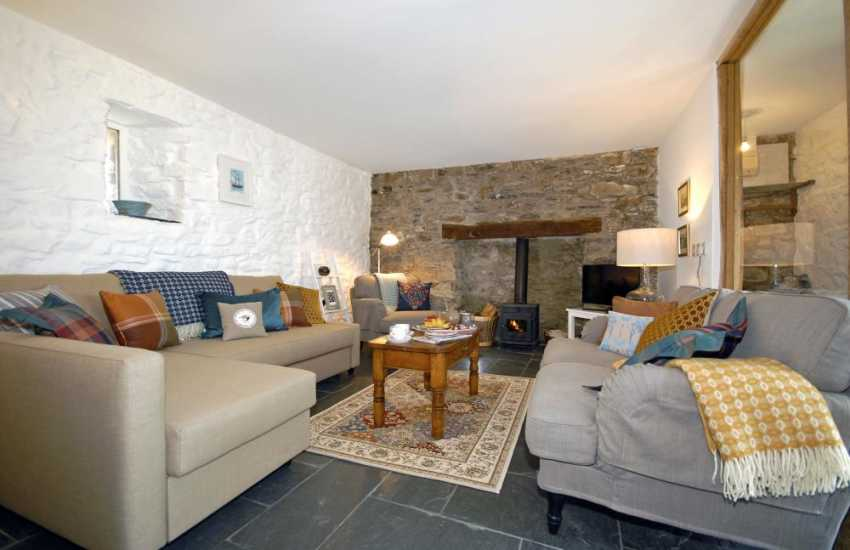 St Davids, Pembrokeshire luxury ground floor apartment - open plan living room with log burning stove