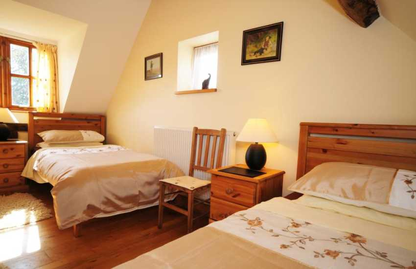 Twin bedroom of holiday cottage in rural countryside