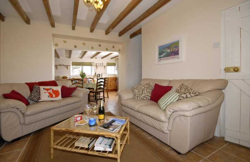 Llangwm holiday cottage - open plan sitting room with log-effect electric stove