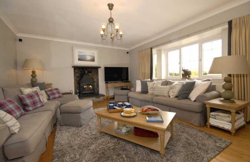Elegant Carmarthenshire holiday house - spacious sitting room with wood burning stove