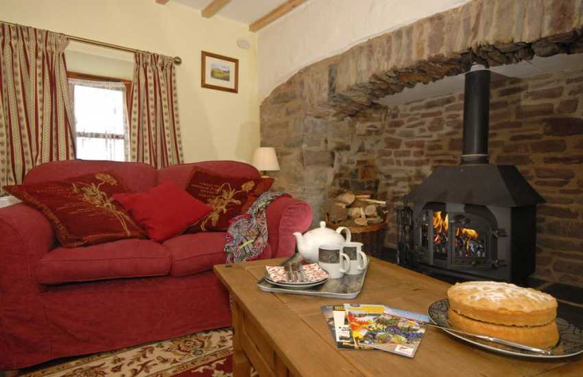 Cosy Laugharne holiday cottage - sitting room with ignlenook