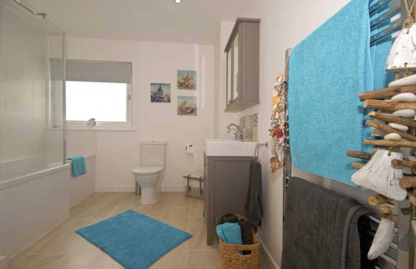 St Davids holiday house - ground floor family bath with shower over