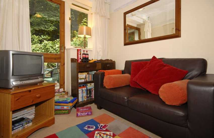 Gower family holiday apartment - children's snug with games and videos