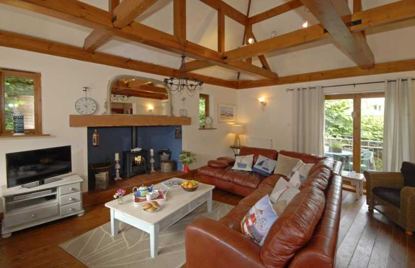 Gower Beach Loft - sitting room with vaulted beams wood burner