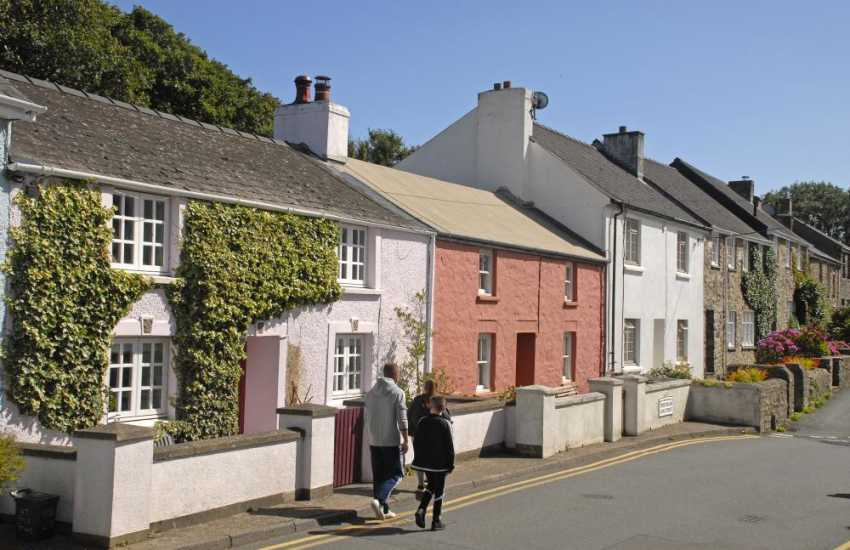 A row of pretty painted Welsh cottages in the tiny city of St Davids