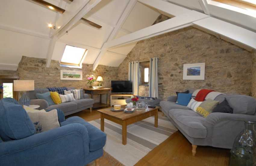 St Davids, Pembrokeshire luxury holiday home - spacious living room with vaulted beamed ceilings